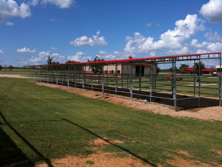 CHRIS COX'S 18 STALL OPEN AIR BARN MANUFACTURED BY LONESTAR BARNS